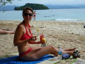 Eating fruit on the beach of Manukan Island