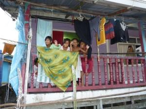 Excited children in the water village